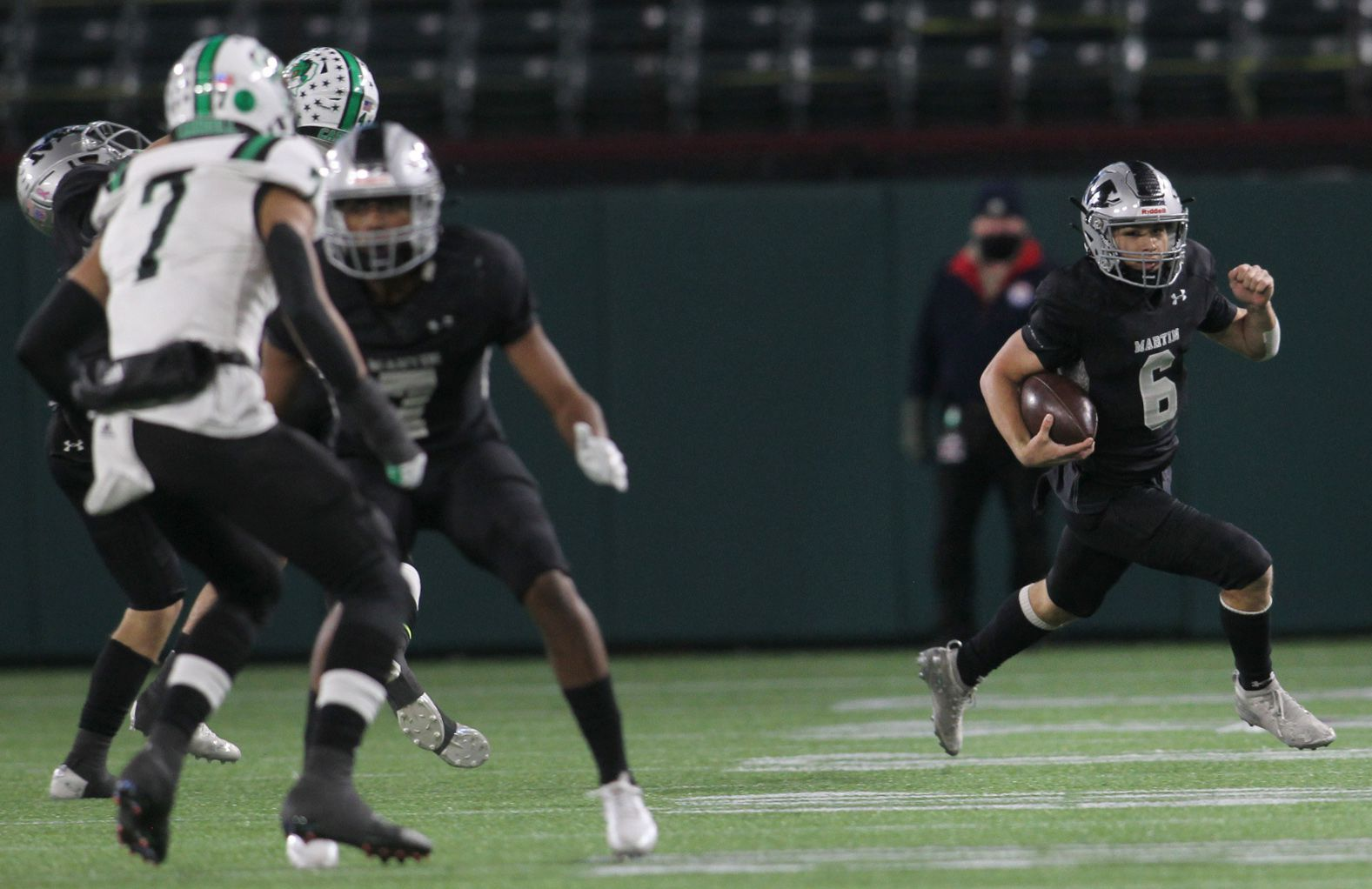 Arlington Martin quarterback Zach Mundell (6) scampers out of the backfield for a big rushing gain during first half action against Southlake. The two teams played their Class 6A Division l Region l semifinal football playoff game held at Globe Life Park in Arlington on December 24, 2020. (Steve Hamm/ Special Contributor)