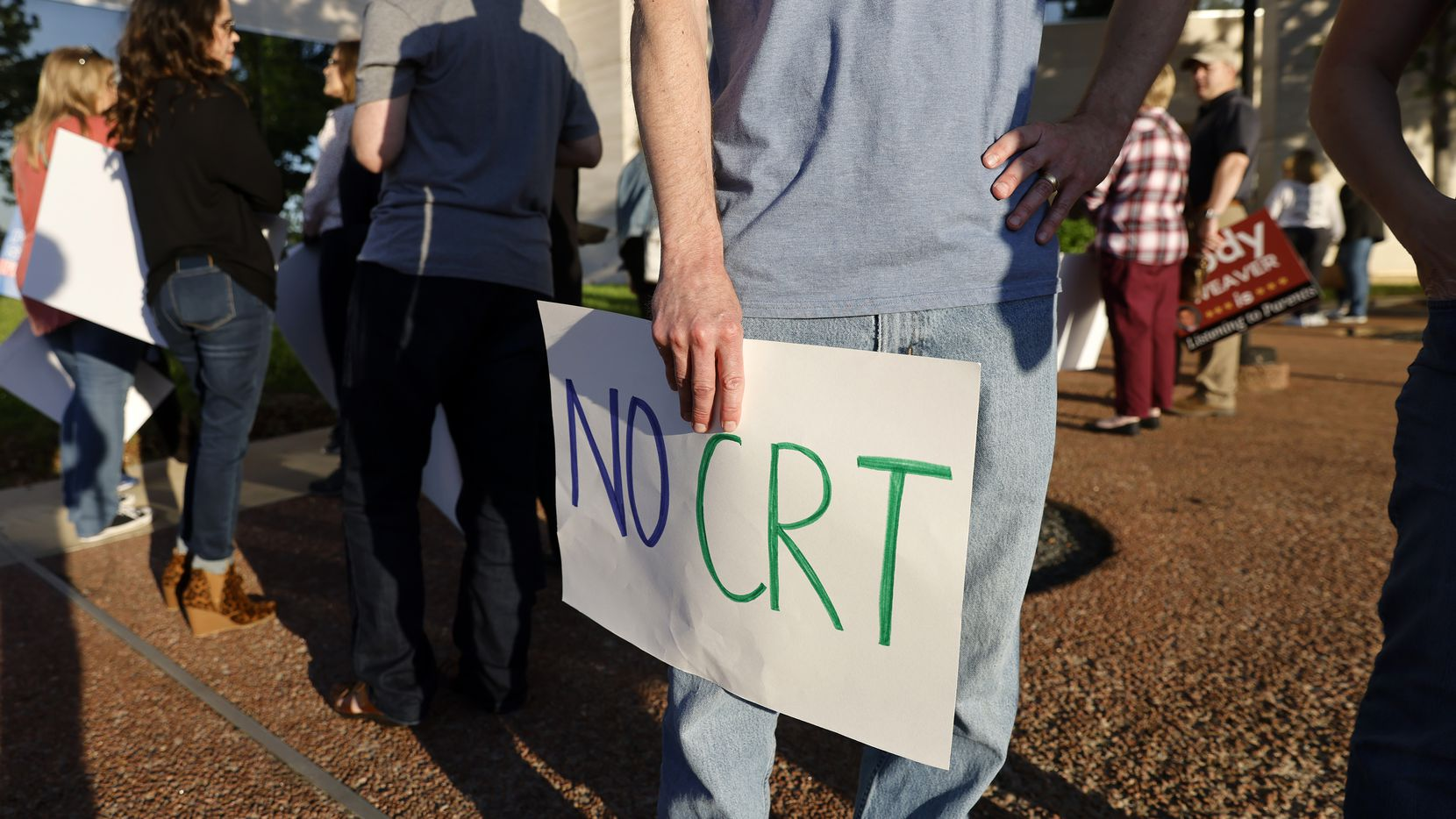 Michael Woodmansee brought a 'No CRT' sign to show concern about critical race theory being taught in schools during a heated debate about diversity and inclusion at Plano ISD's board meeting in the Plano Independent School District Administration Building, May 4, 2021.