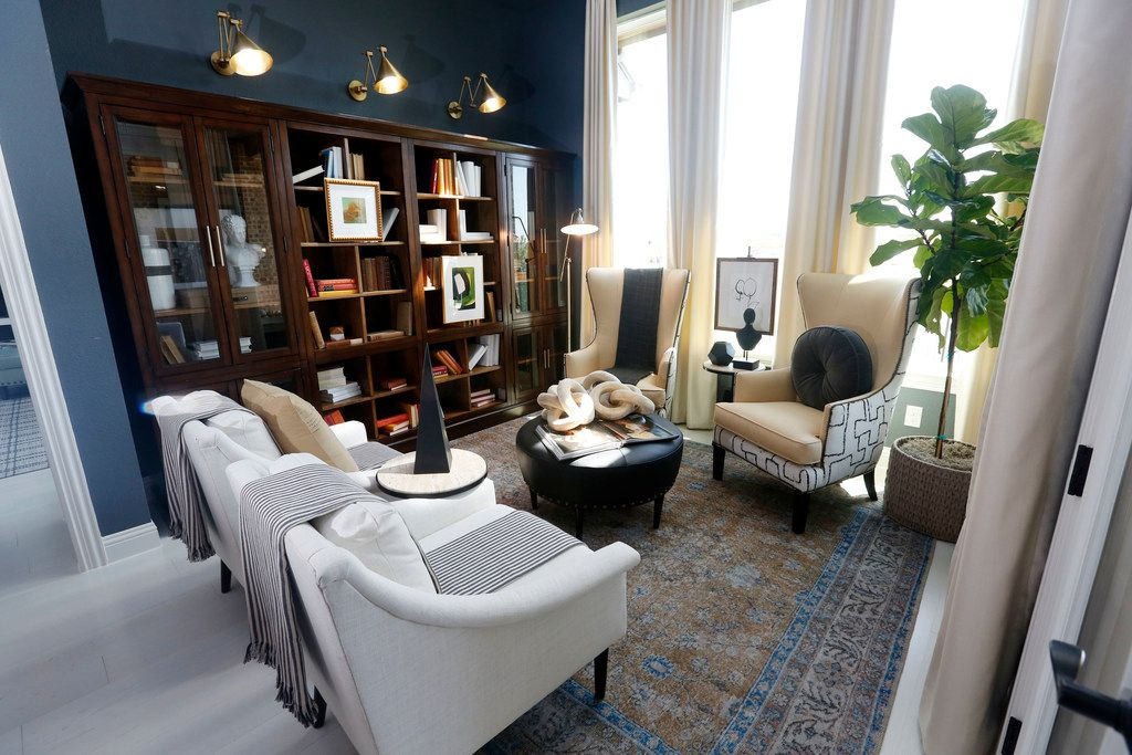 This room could have been designed as a breakfast nook. Architect Gonzalo Romero, of Highland Homes, says he loved that designer Tiffany Brooks chose to turn it into a library instead.