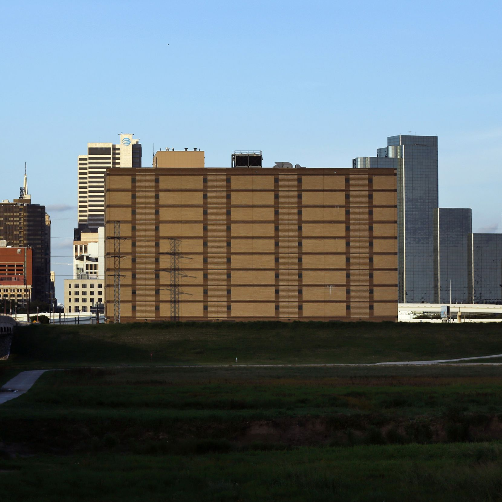 The former Dawson State Jail (center) is blessedly headed for a remaking as an entry point to the forthcoming Trinity park.