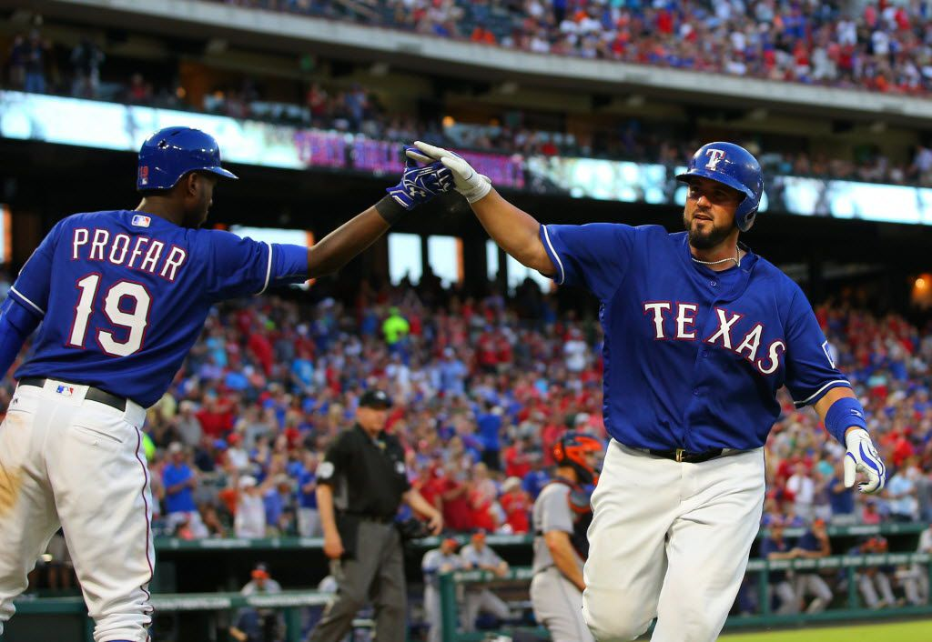 FILE - ARLINGTON, TX - JUNE 07: Jurickson Profar #19 of the Texas Rangers congratulates Bobby Wilson #6 for hitting a solo home run in the fifth inning against the Houston Astros at Globe Life Park in Arlington on June 7, 2016 in Arlington, Texas. (Photo by Rick Yeatts/Getty Images)