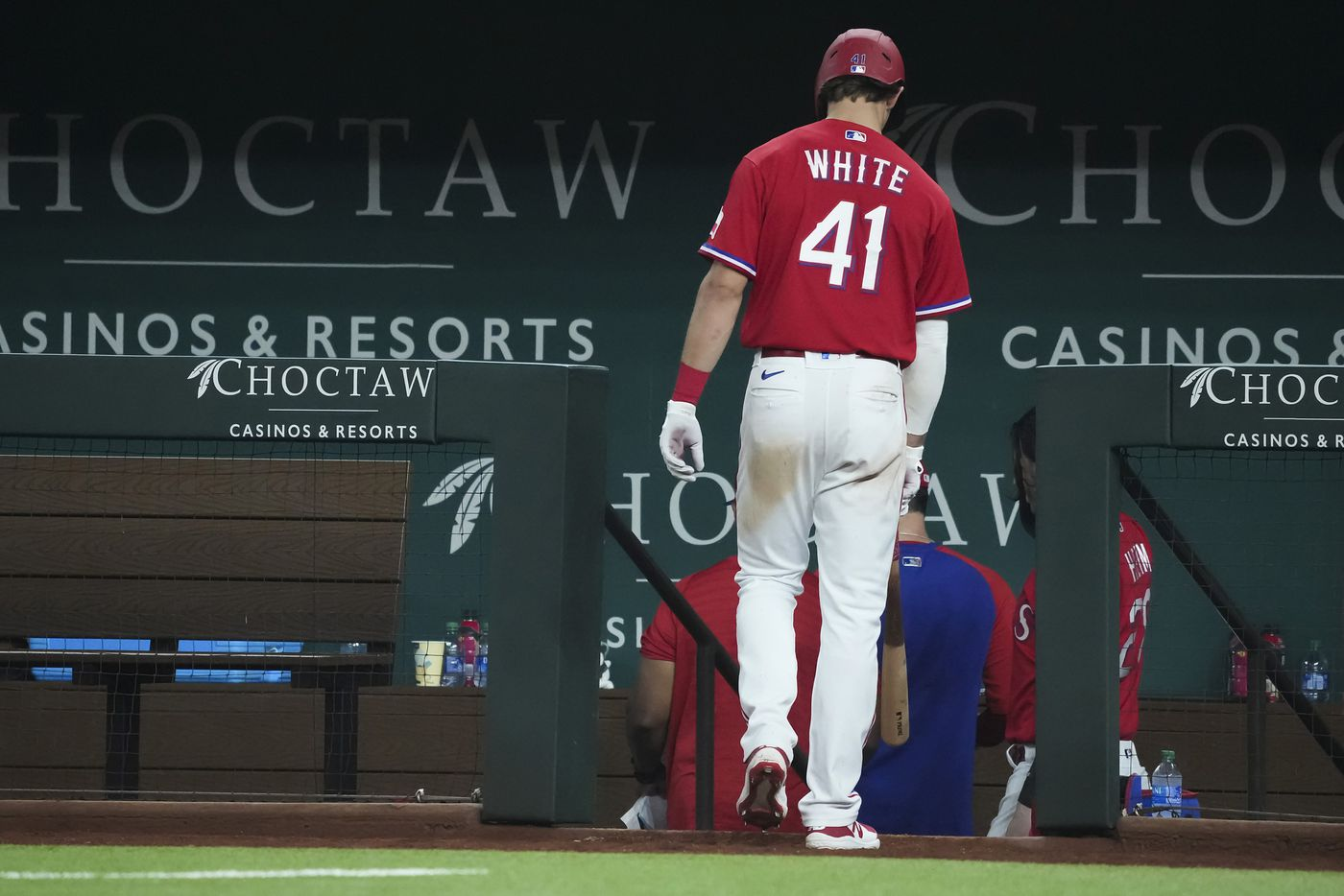 Texas Rangers left fielder Eli White heads for the dugout after striking out to end the tenth inning of a loss to the Minnesota Twins at Globe Life Field on Friday, June 18, 2021.