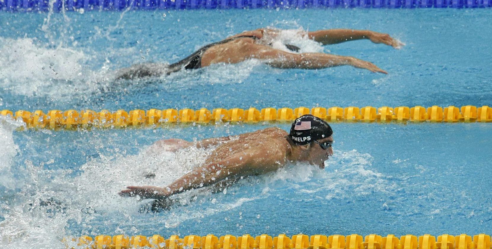 FILE - Michael Phelps of the U.S. (bottom) races the third leg of the men's 4x100M medley relay on Sunday, Aug. 17, 2008, at the National Aquatics Center in Beijing, China.