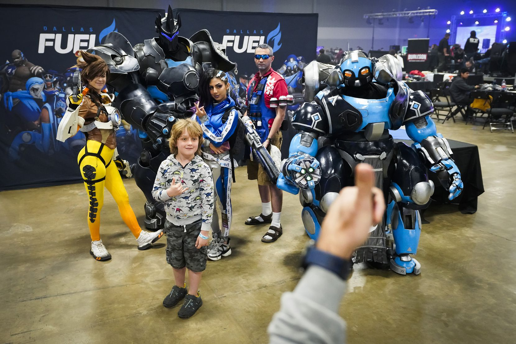 Noah Scholz poses for photos with cosplay characters in the Dallas Fuel opening weekend fan festival before a Overwatch League match against the Los Angeles Valiant at the Arlington Esports Stadium on Saturday, Feb. 8, 2020, in Arlington.
