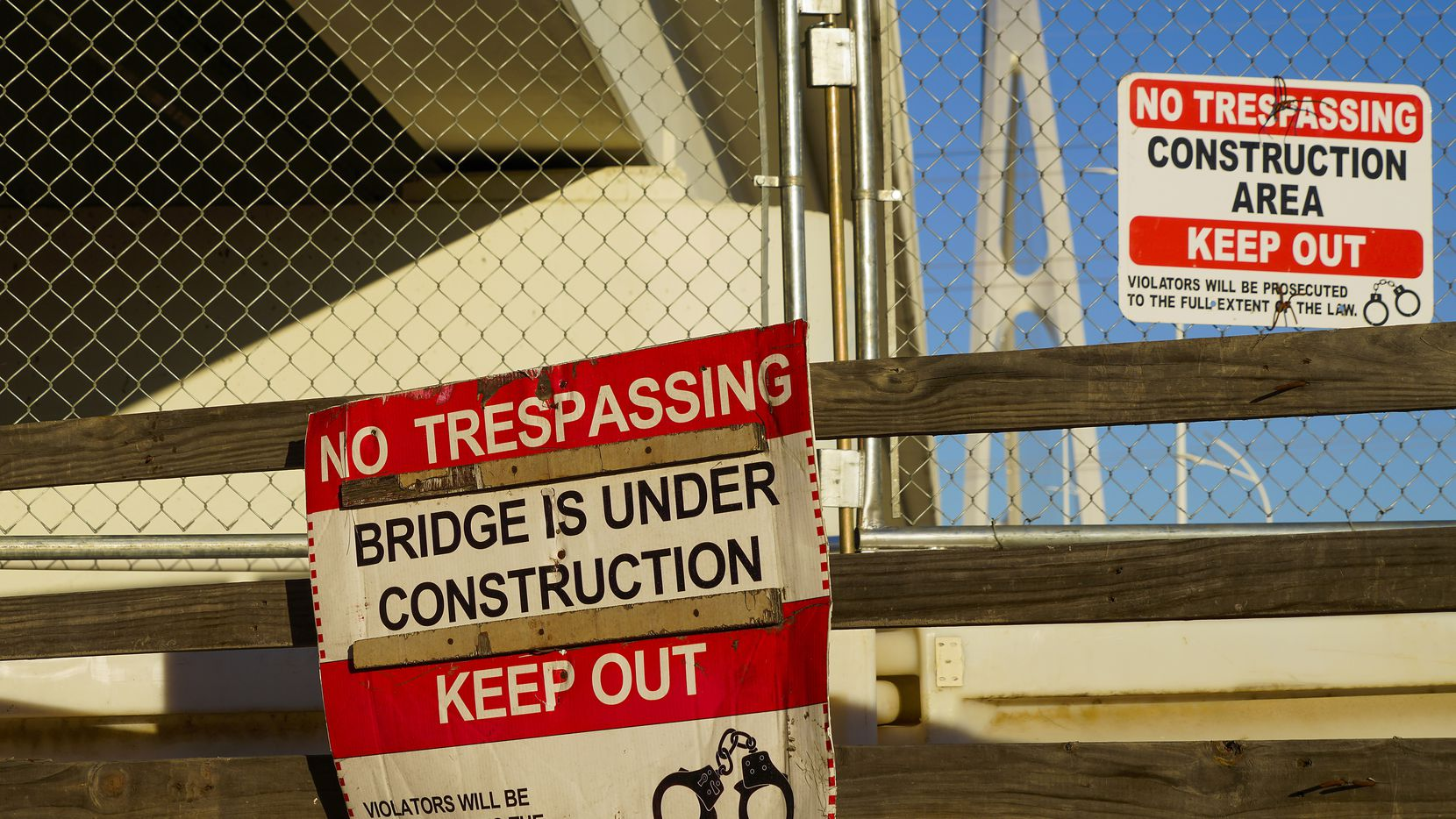 A barricade posted at an entrance blocks the pedestrian bridges on the hike and bike portion of the Margaret McDermott Bridge over the Trinity River in downtown Dallas on Monday, Jan. 4, 2021. Issues related to the cable anchorage system have been at the center of a long-running multi-agency dispute over the pedestrian portion of the $115 million Interstate 30 bridge.