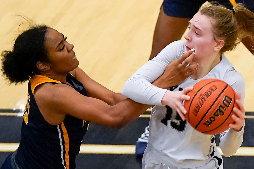 Bishop Lynch guard Paige Bradley (15) gets a hand to the face from Prestonwood Christian forward Morgan Hervey (35) as she drives to the basket during a TAPPS 2-6A high school girls basketball game on Friday, Feb. 7, 2020, in Dallas. Bishop Lynch won the game 59-54. (Smiley N. Pool/The Dallas Morning News)