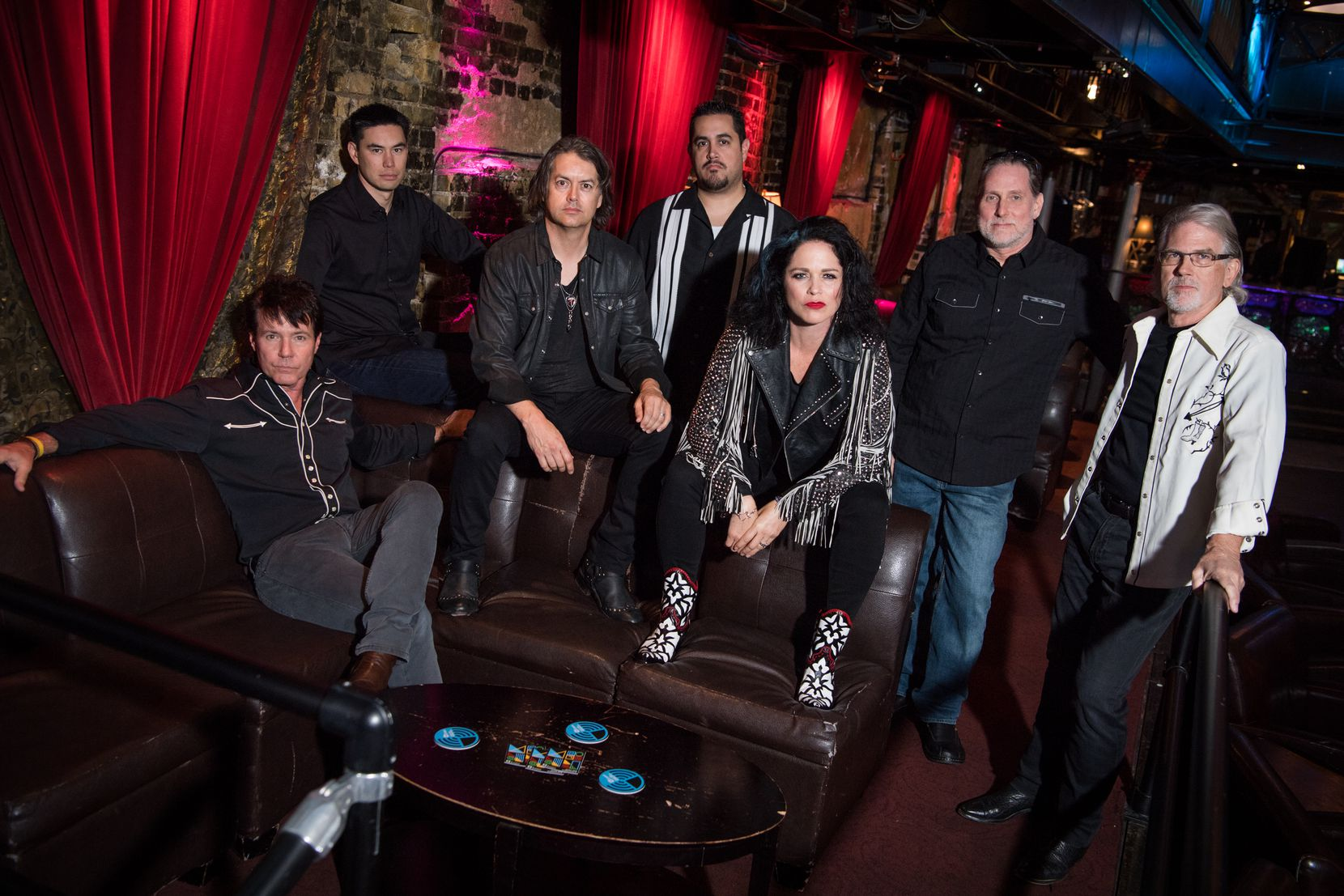 Members of the rock group GEM at the Varsity Theater in Minneapolis in June 2019. The group is led by Enseo CEO Vanessa Ogle and includes her husband, Paul Bullock, and Enseo executives.   From left: Jeff Smith, vice president-sales; Kevin Sweeney, vice president-product marketing; Bullock; Alex Ocampo, product manager; Ogle; Craig Smith, director of engineering; and Peyton Wimmer, chief cultural officer.