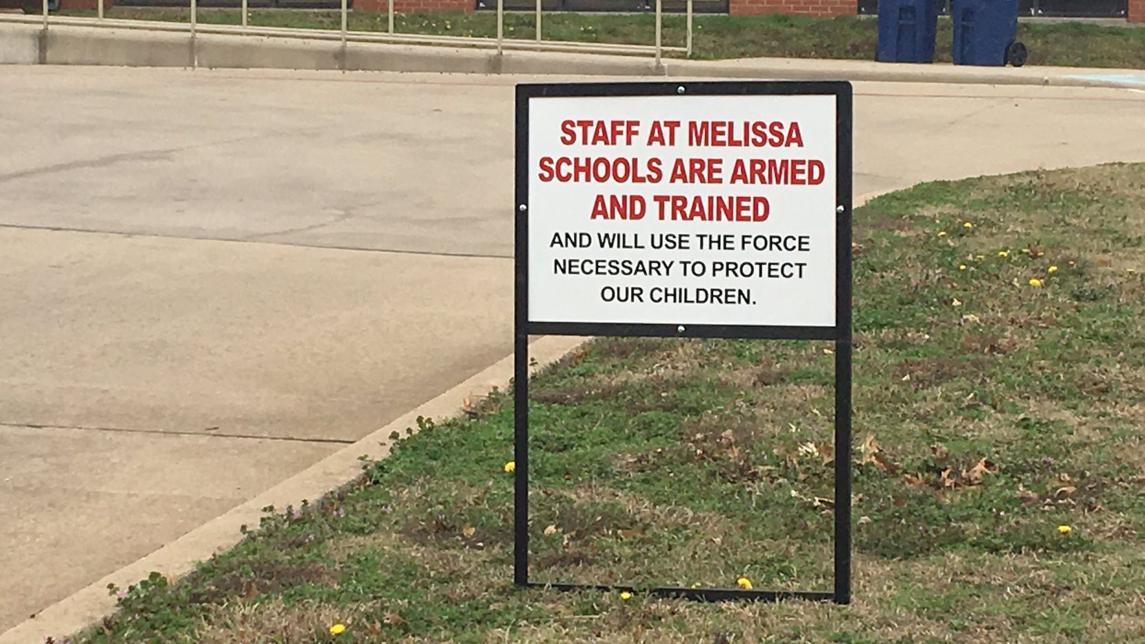 Melissa ISD signs placed outside schools warn staff is armed and trained.