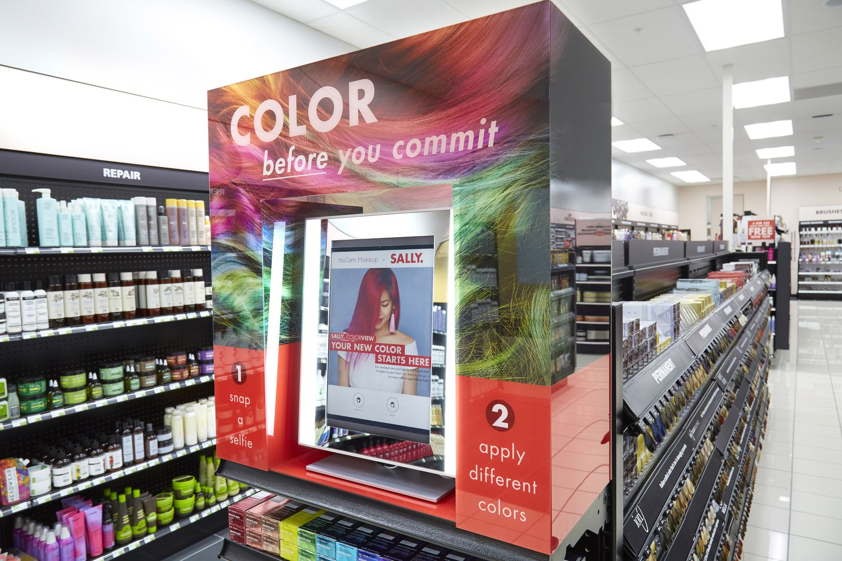 1 of 85 This interactive kiosks is being added to newly remodeled Sally Beauty Supply stores. The technology allows customers to see how they would look with a different hair color.