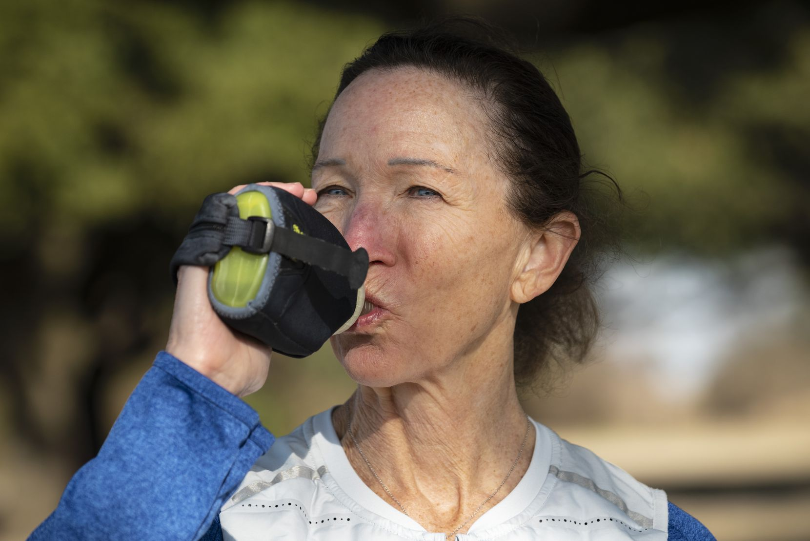 Maggie Riba, 62, takes water with her on her daily runs. The running coach and personal trainer has noticed that it improves her energy levels.