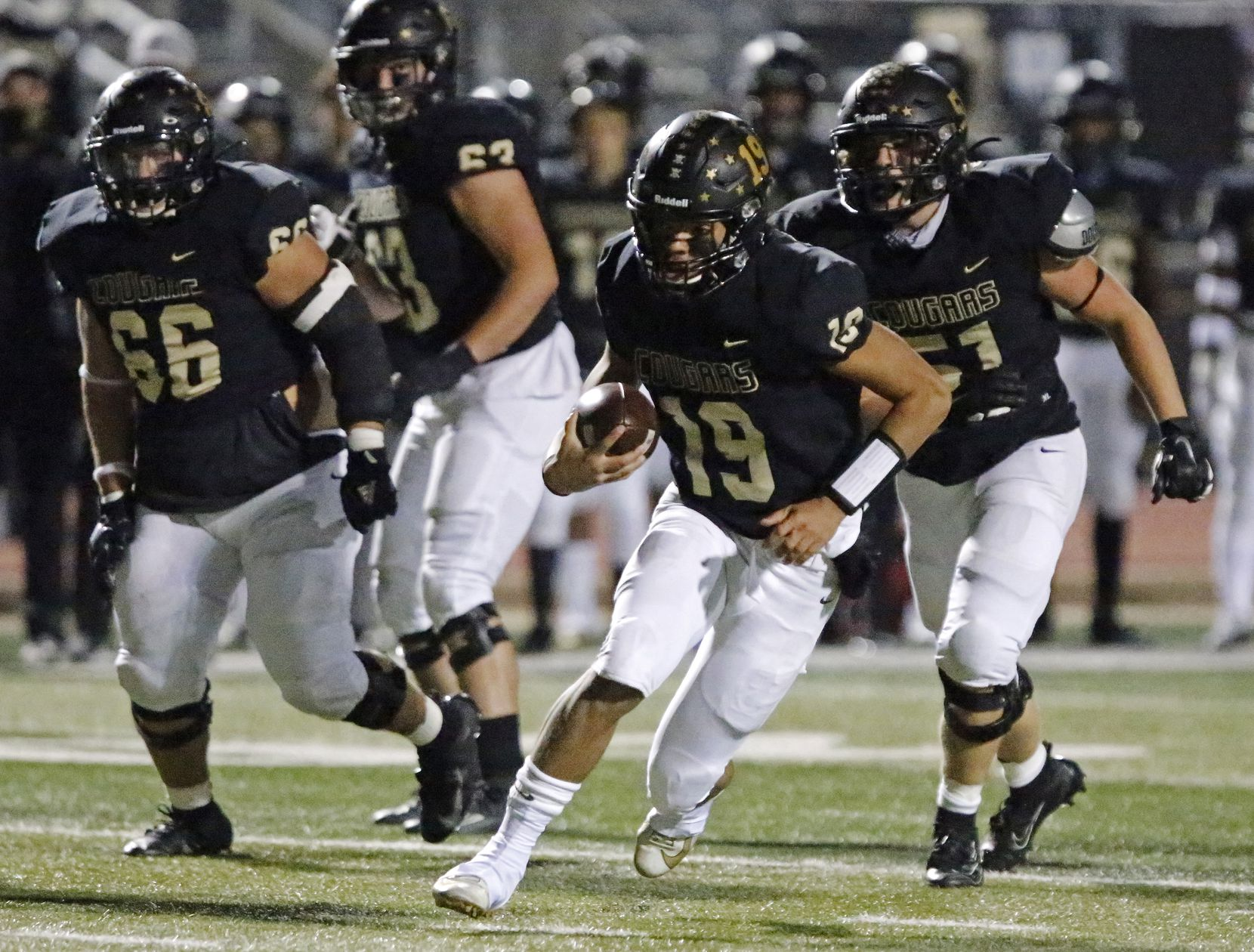 The Colony High School quarterback Jonathan Roberson (19) runs for yardage during the first half as The Colony High School hosted Frisco Reedy High School at Tommy Briggs Stadium on Friday night, December 4, 2020.  (Stewart F. House/Special Contributor)