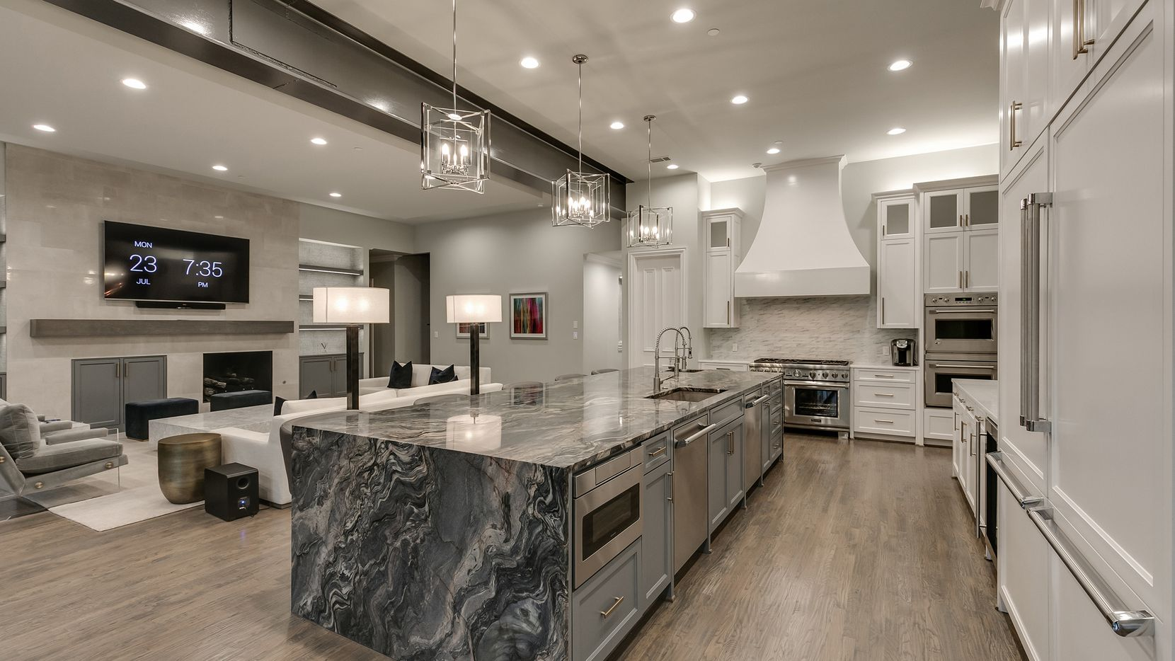 The estate at 2204 Plantation Lane in Plano is offered at $4,650,000. The kitchen includes a 14-foot granite island imported from Spain.
