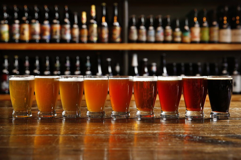 Beers (from left) Blood and Honey, Dallas Blonde, Tulsa Rugby Ale, Bella, Public Enemy #1, Tupps IPA, Red King, Numb Comfort and Pecan Porter photographed at Craft and Growler in Dallas on Oct. 15, 2015.