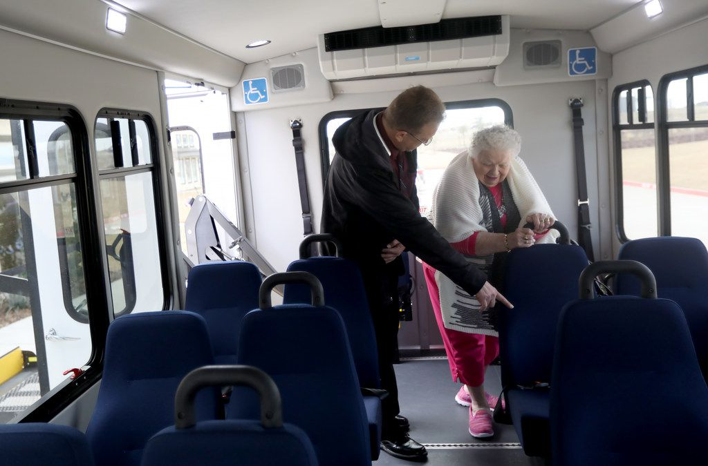 Envoy America driver Kris Werner helps Jeannyne Reston select a seat on the bus at The Heritage at Twin Creeks in Allen.  The group of seniors was heading to Texas Roadhouse for lunch.
