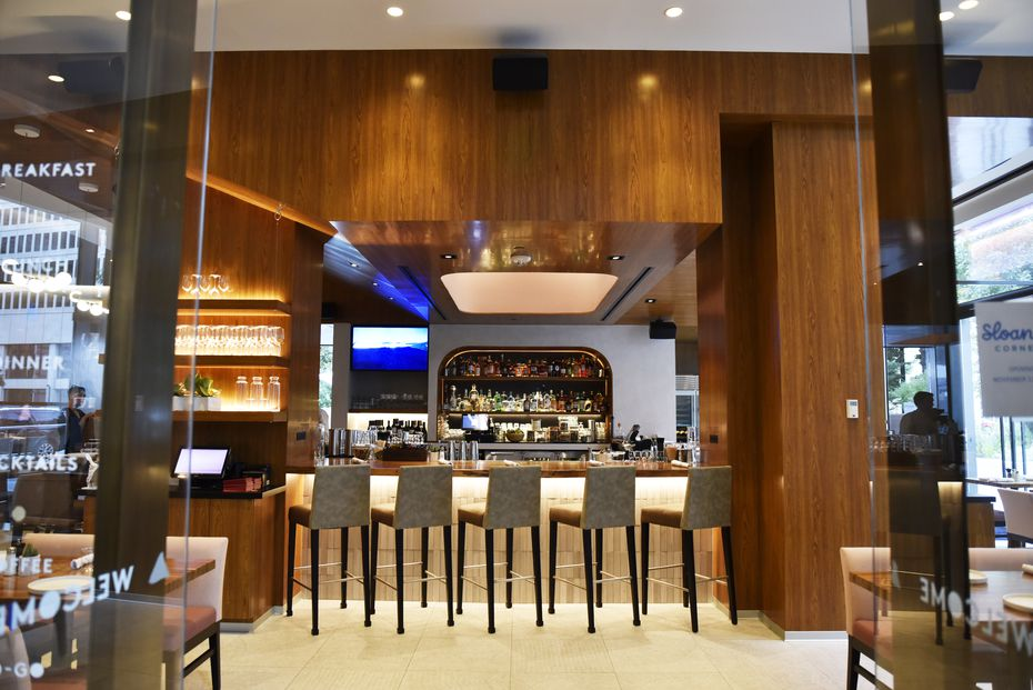 The bar at Sloane's Corner is located in the middle of the restaurant.