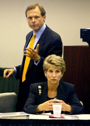 Then-state Rep. Steve Wolens, with his wife and then-Dallas Mayor Laura Miller, in 2003, when he passed a law making it harder for people to procure mail-in ballot applications.