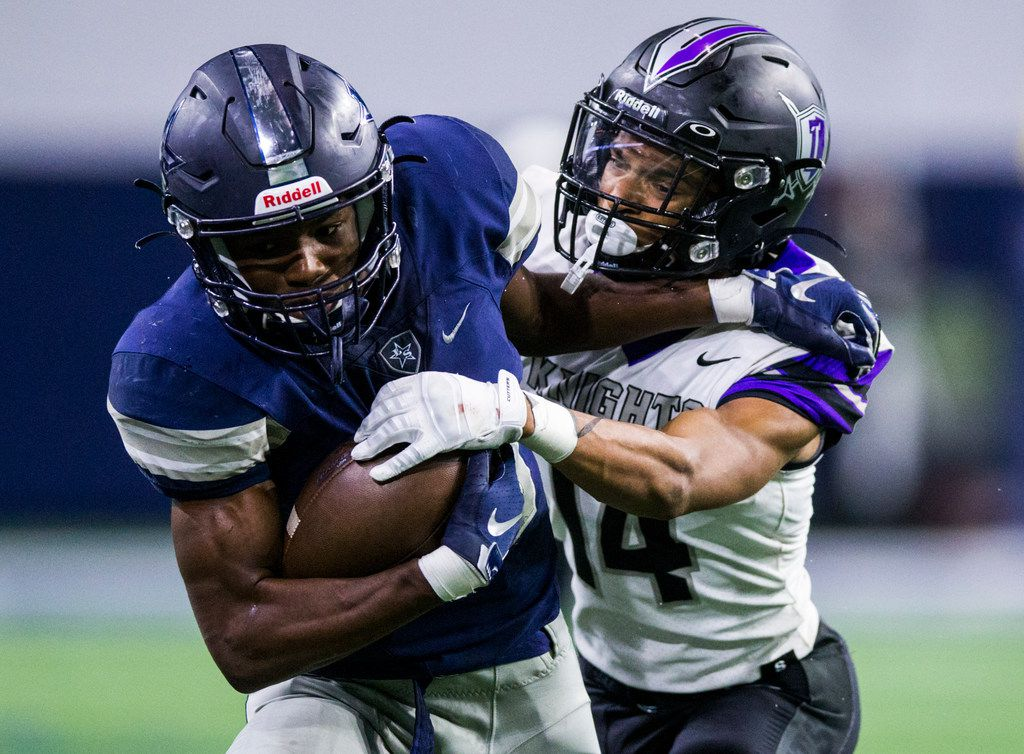 Frisco Lone Star wide receiver Marvin Mims (18) holds on to the ball while fending off Frisco Independence defensive back Caleb Ellis (14) during the fourth quarter of a District 5-5A Division I high school football game between Frisco Independence and Frisco Lone Star on Thursday, October 10, 2019 at the Ford Center at The Star in Frisco.