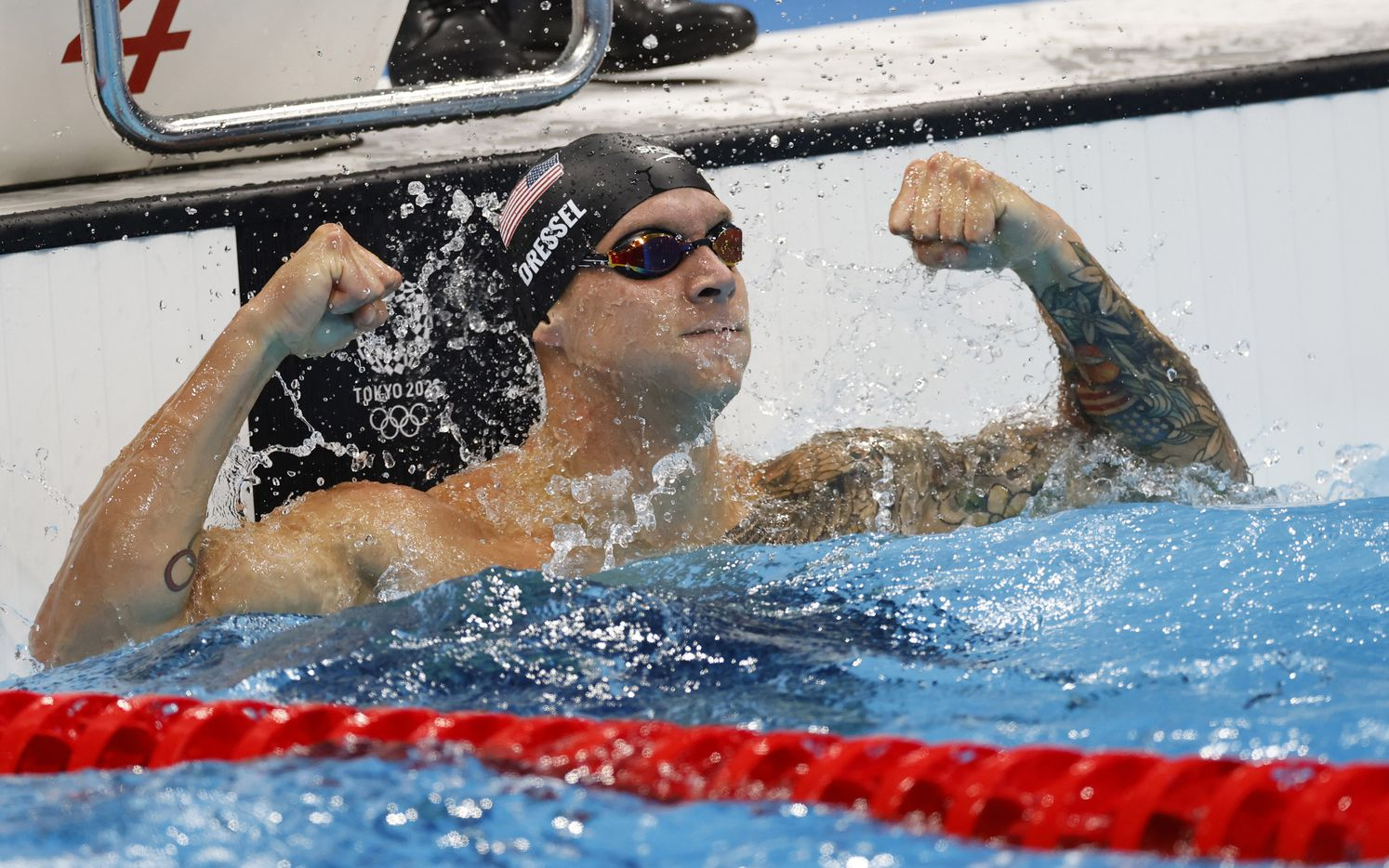 USA's Caeleb Dressel celebrates after winning the men's 50 meter freestyle final during the postponed 2020 Tokyo Olympics at Tokyo Aquatics Centre, on Sunday, August 1, 2021, in Tokyo, Japan. Dressel earned a gold medal with a time of 21.07 seconds. (Vernon Bryant/The Dallas Morning News)
