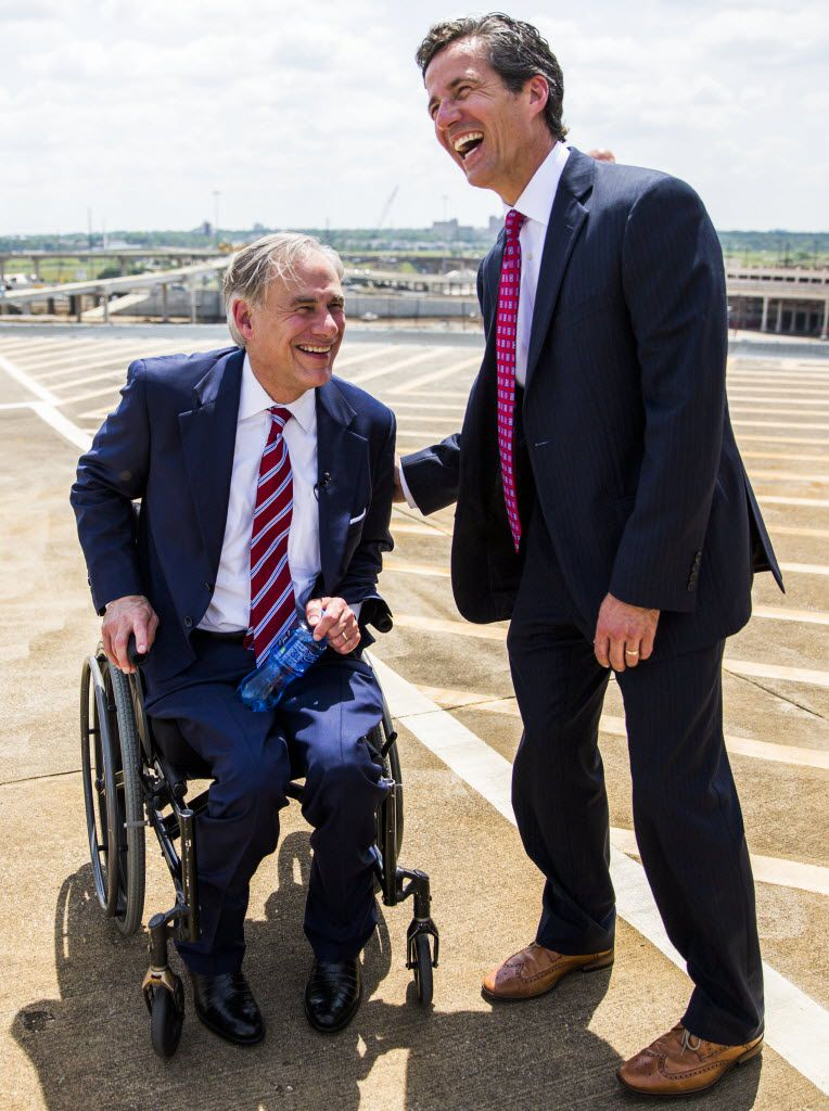 Sen. Kelly Hancock, R-North Richland Hills, right, shared a laugh with Gov. Greg Abbott during a transportation bill signing. (June 2015 Staff File Photo)