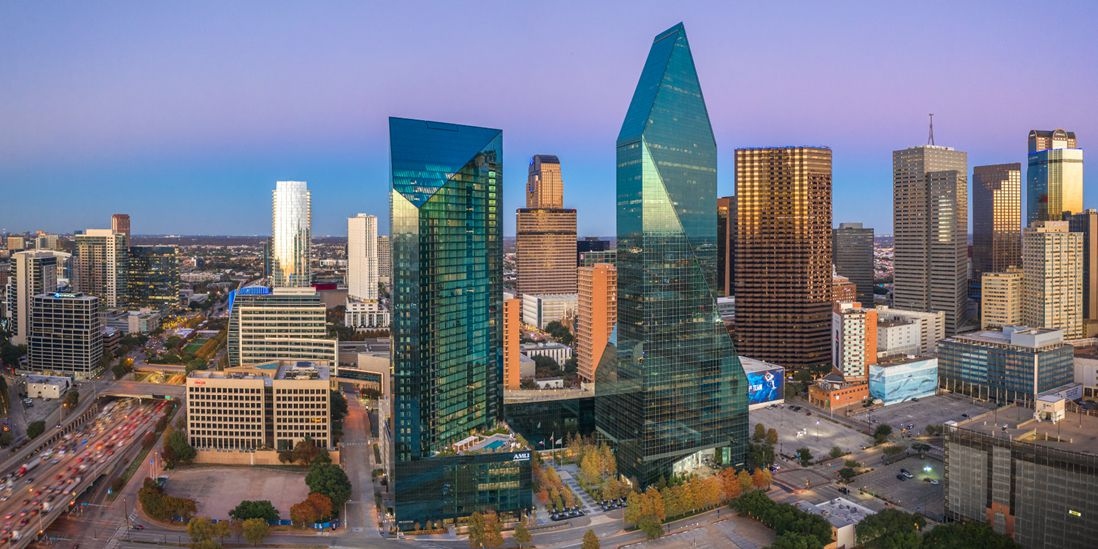 The Fountain Place tower, pictured to the right of the new Amli apartment tower, is one of downtown Dallas' best-known skyscrapers.
