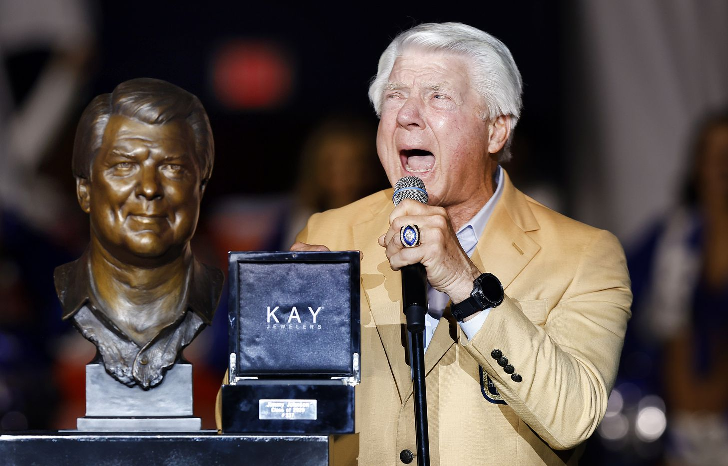 """Former Dallas Cowboys head coach and Pro Football Hall of Famer Jimmy Johnson yells """"How 'bout them Cowboys!"""" during his  Hall ring ceremony speech during halftime of the Philadelphia Eagles game at AT&T Stadium in Arlington, Monday, September 27, 2021. (Tom Fox/The Dallas Morning News)"""