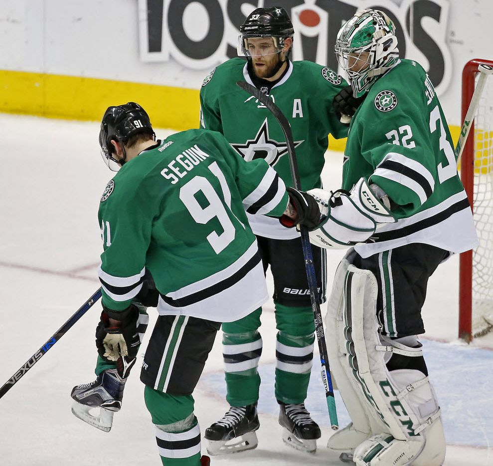 Dallas Stars goalie Kari Lehtonen (32) and defenseman Alex Goligoski (33) watch center Tyler Seguin checking on his right achilles at the end of the Stars' 4-3 win over Tampa Bay Lightning at American Airlines Center in Dallas, Thursday, March 17, 2016. (Jae S. Lee/The Dallas Morning News)