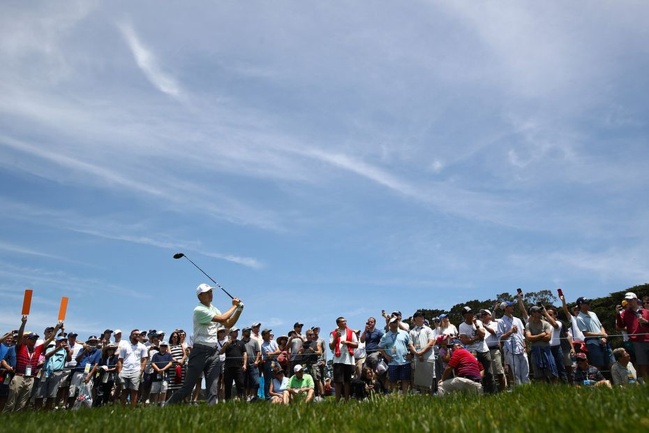 PEBBLE BEACH, CALIFORNIA - JUNE 10: Jordan Spieth plays a shot from the ninth tee as fans look on during a practice round prior to the U.S. Open at Pebble Beach Golf Links on June 10, 2019, in Pebble Beach, Calif. (Photo by Ezra Shaw/Getty Images)