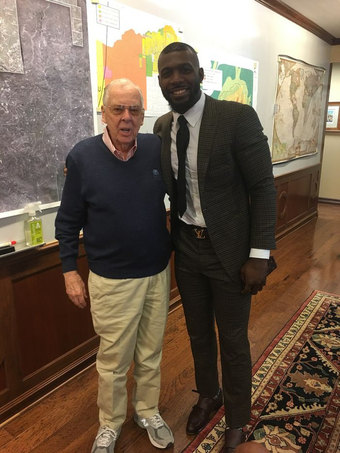 Pickens posed with former Dallas Cowboys wide receiver and Oklahoma State University all-American Dez Bryant in April 2018.