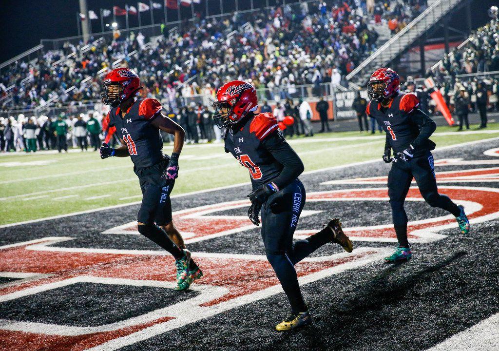 The Cedar Hill longhorns celebrate a touchdown during a high school football match up between Cedar Hill and DeSoto on Thursday, Nov. 7, 2019. (Ryan Michalesko/The Dallas Morning News)