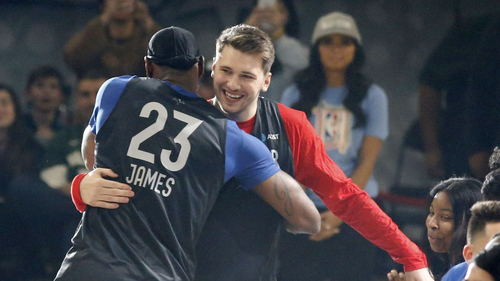 Lakers guard/forward LeBron James (23) and Mavericks guard Luka Doncic (77) meet after player introductions during practice for the 2020 NBA All-Star Game at Wintrust Arena in Chicago on Saturday, Febr. 15, 2020.