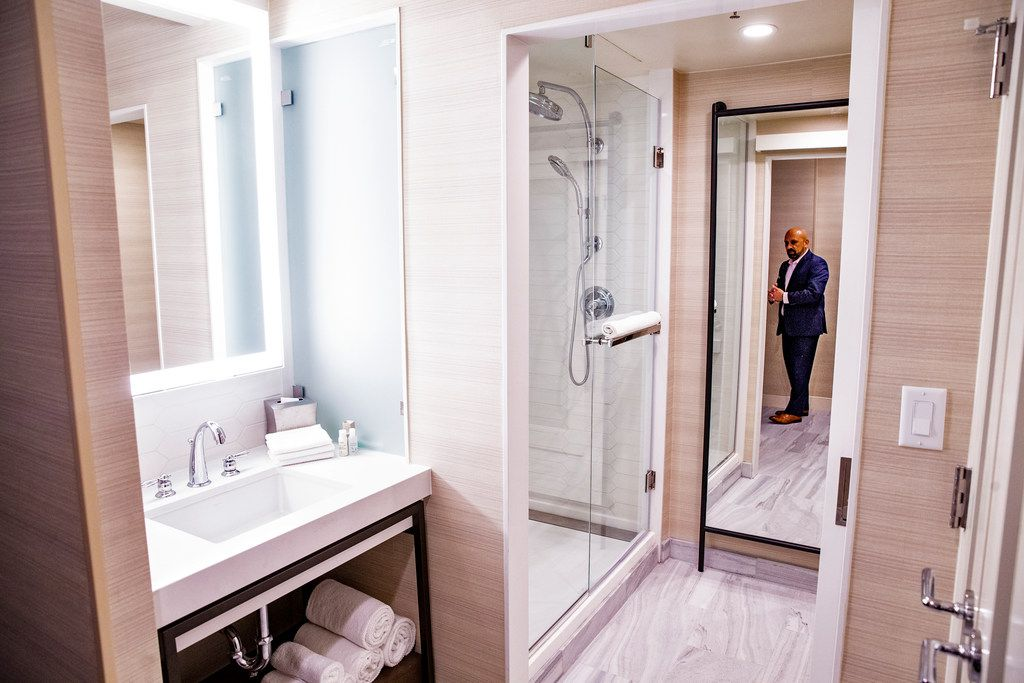 Chris Pilavakis, general manager of Renaissance Dallas hotel, stands in a newly renovated room at the hotel. The hotel removed most bathtubs, and opted for showers in part to attract younger patrons. The hotel plans to have all of their rooms completed by 2019.