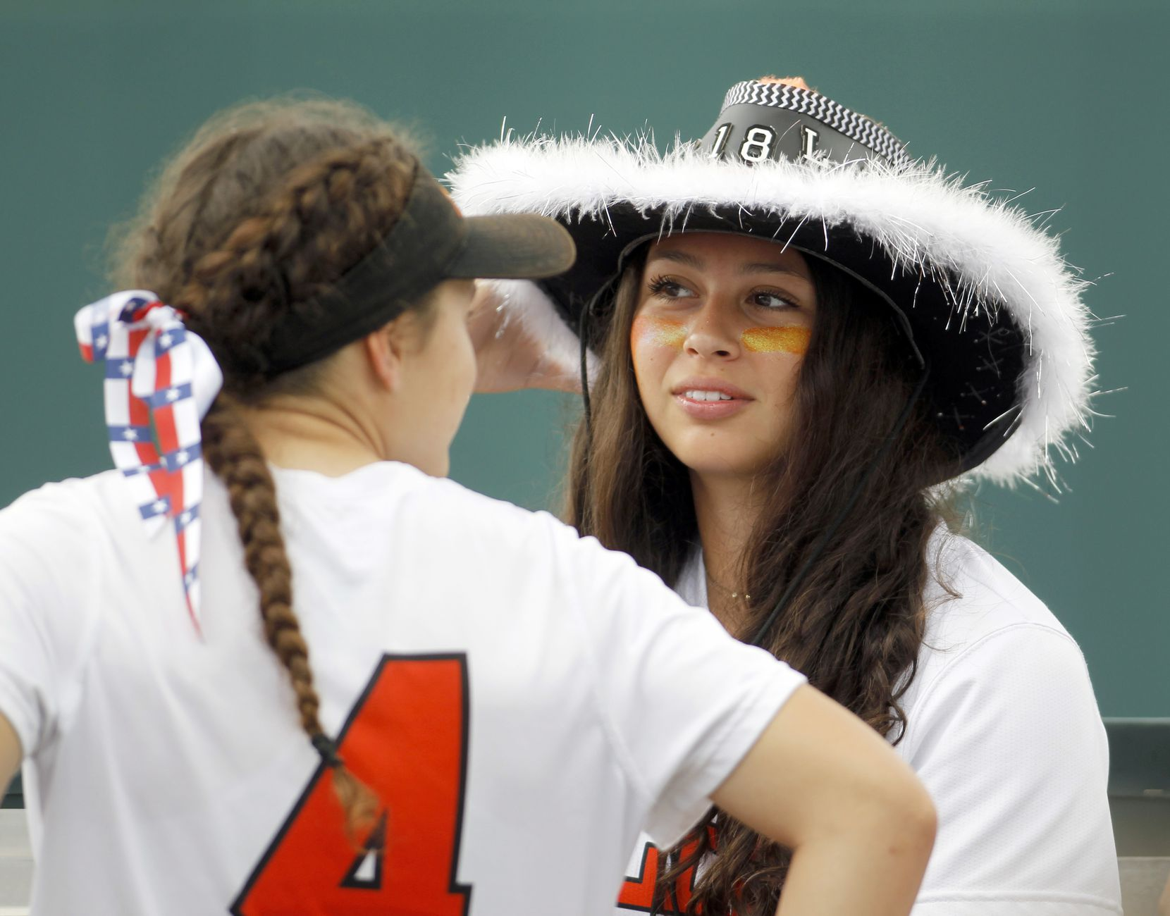Aledo team manager Ana Flores (5), right, spends a light moment with Lady Cats infielder Hannah Pack (4) while waiting for the conclusion of the sate 4a game. The two teams played their UIL 5A state softball championship game at Red and Charline McCombs Field on the University of Texas campus in Austin on June 5, 2021. (Steve Hamm/ Special Contributor)