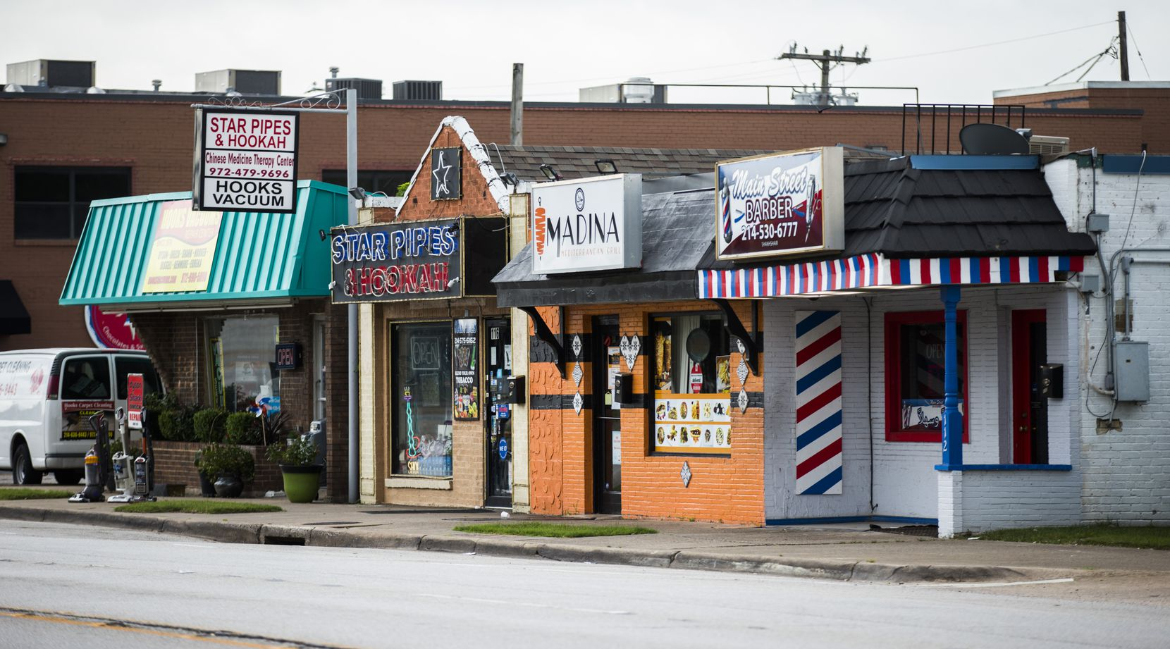 Businesses on the 100 block of East Main Street in old downtown Richardson, an area set for redevelopment.