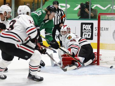 Dallas Stars left wing Roope Hintz (24) scores a goal on Chicago Blackhawks goaltender Kevin Lankinen (32) during the first period of play at American Airlines Center on Tuesday, February 9, 2021in Dallas. (Vernon Bryant/The Dallas Morning News)