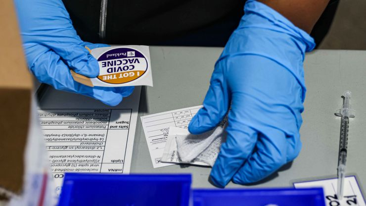 Nurse Lisa Taylor gets a dose of the Pfizer-BioNTech COVID-19 vaccine for the next patient at Ellis Davis Fieldhouse, a Parkland Hospital testing and vaccine location, in Dallas on Wednesday, March 3, 2021.