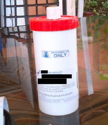 A compounded pain cream container involved in a federal health care fraud case.