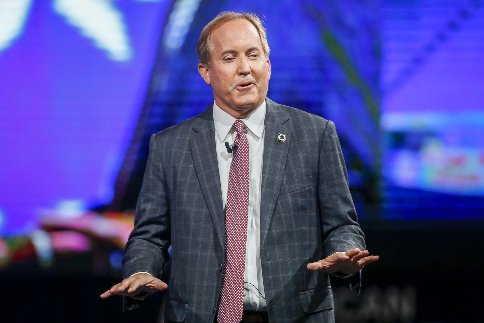 Texas Attorney General Ken Paxton gives remarks at the Conservative Political Action Conference on Sunday, July 11, 2021, in Dallas. (Elias Valverde II/The Dallas Morning News)