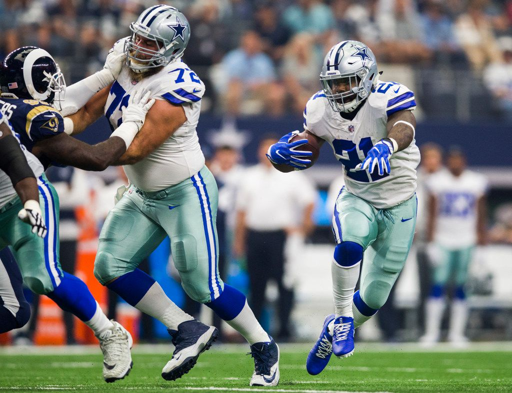 Dallas Cowboys running back Ezekiel Elliott (21) runs the ball during the first quarter of an NFL football game between the Los Angeles Rams and the Dallas Cowboys on Sunday, October 1, 2017 at AT&T Stadium in Arlington, Texas. (Ashley Landis/The Dallas Morning News)