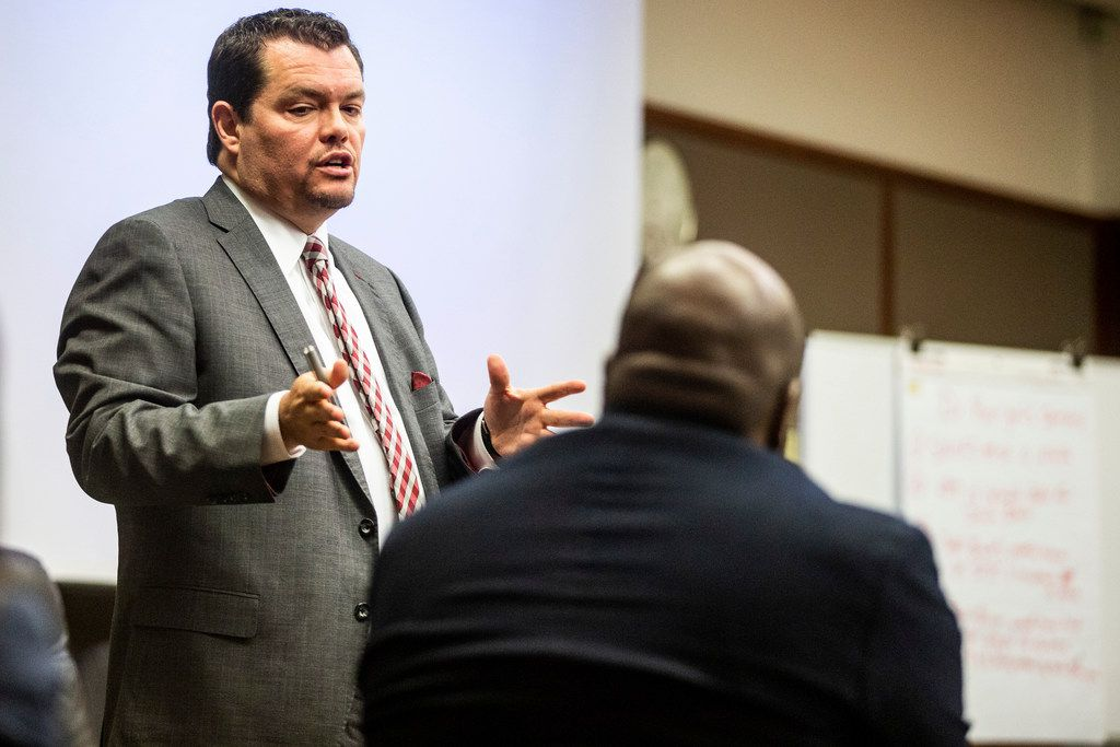 Carlos Cortez, a lawyer for the bar management company, motions towards Josh Brent as he makes a statement  during a court session at George Allen civil courthouse in Dallas on Monday, December 10, 2018. Josh Brent drove drunk and caused a crash that killed Stacey Jackson's son Jerry Brown. Jackson is suing Brent and the bar that served him.