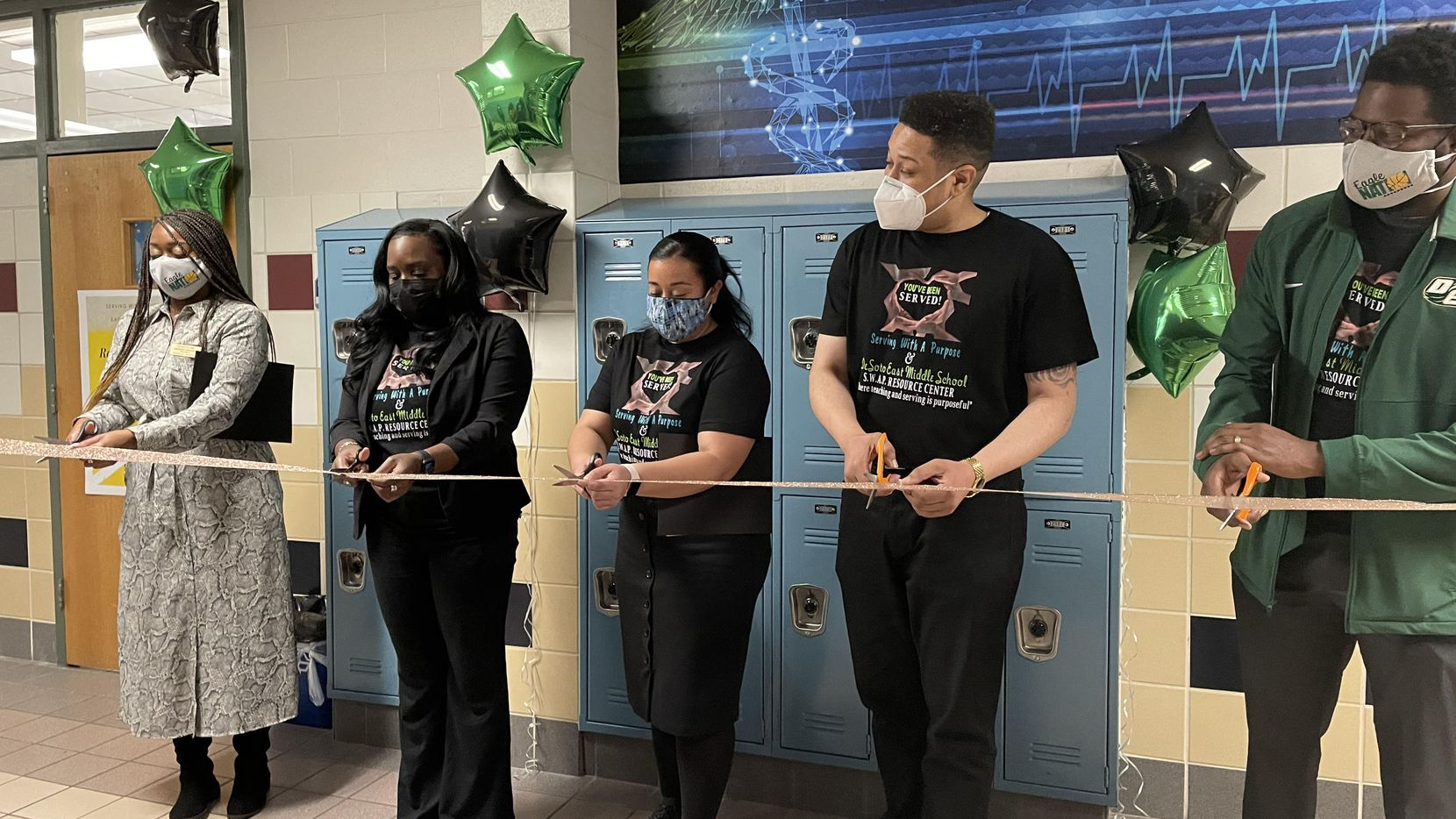 DeSoto ISD leadership cut the ribbon on a new partnership between the district and Serving with a Purpose. From left to right: DeSoto ISD Board President Amanda Sargent, teacher Melissa Toney, counselor Brittany Torres, campus principal Travis Anderson and Superintendent D'Andre Weaver.