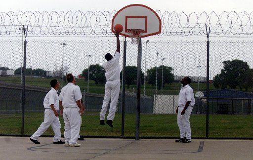 May 9,2000  Inmates at the Hutchins State Jail play a game of basketball in the recreation yard at the jail. Hutchins State Jail is located  south of Dallas at 1500 East Langdon Road.