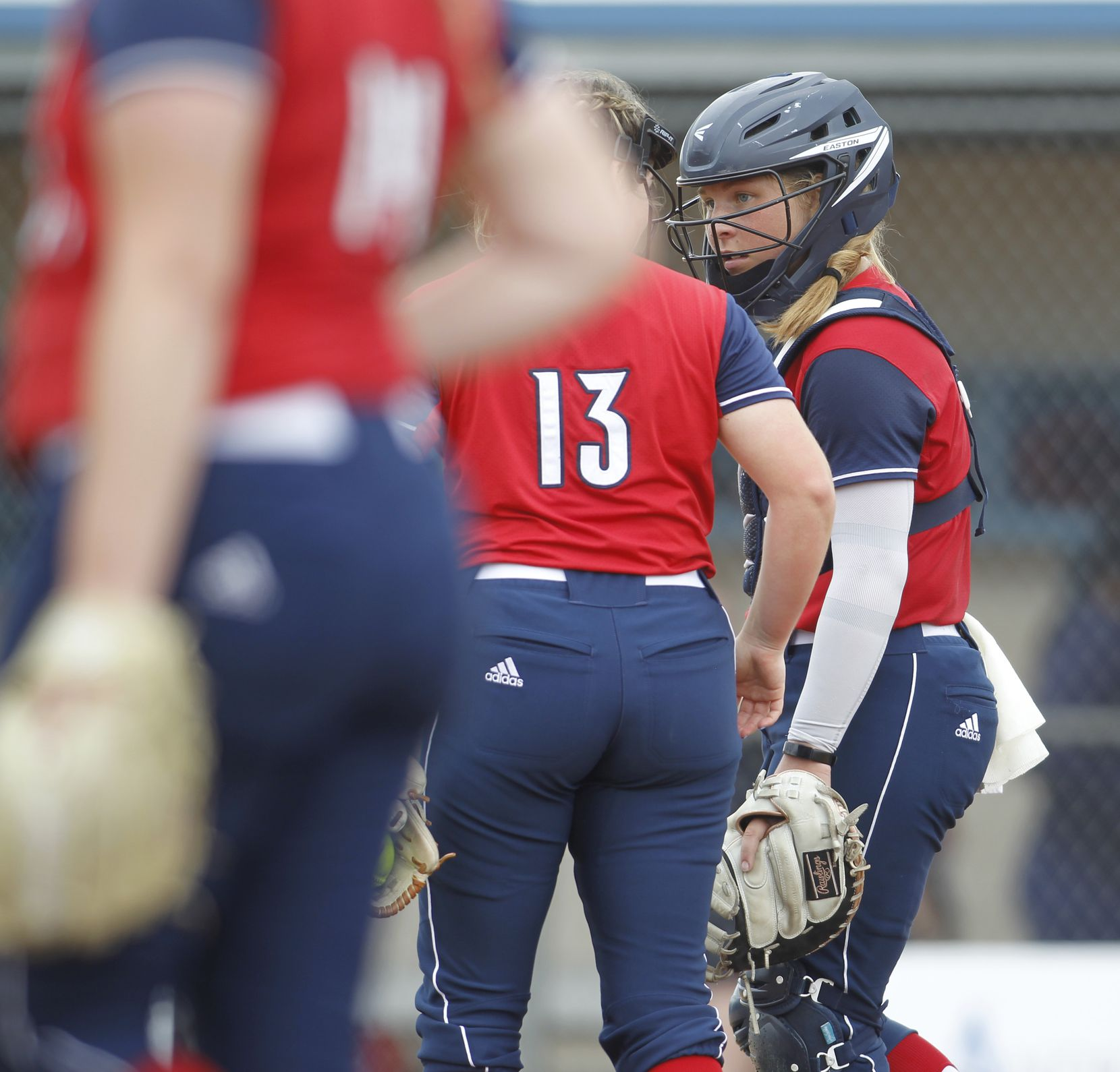 Plano John Paul ll catcher Aubrey Hutzler (6) speaks with pitcher Emily Jonte (13) during a break in the action of the 4th inning of their game against Antonian College Prep. The Cardinals won the state softball title with a 4-2 victory. The two teams played their TAPPS state Division 1 championship game at Waco ISD Softball Complex in Waco on May 15, 2021.