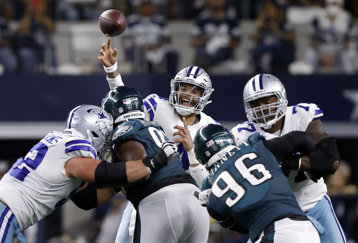 Dallas Cowboys quarterback Dak Prescott (4) releases a pass over the Philadelphia Eagles defensive line during the second quarter at AT&T Stadium in Arlington, Monday, September 27, 2021. (Tom Fox/The Dallas Morning News)