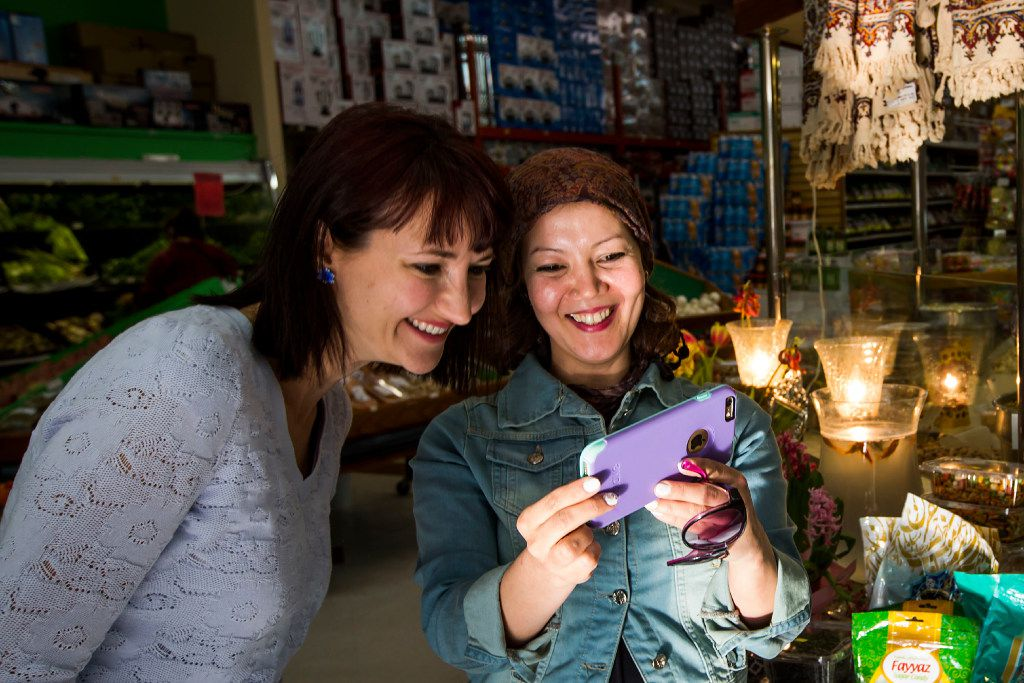Jamileh Jafari (right) shops with Olga Pope of the Sunday Supper Series at Shahrzad Mediterranean Market in Richardson.