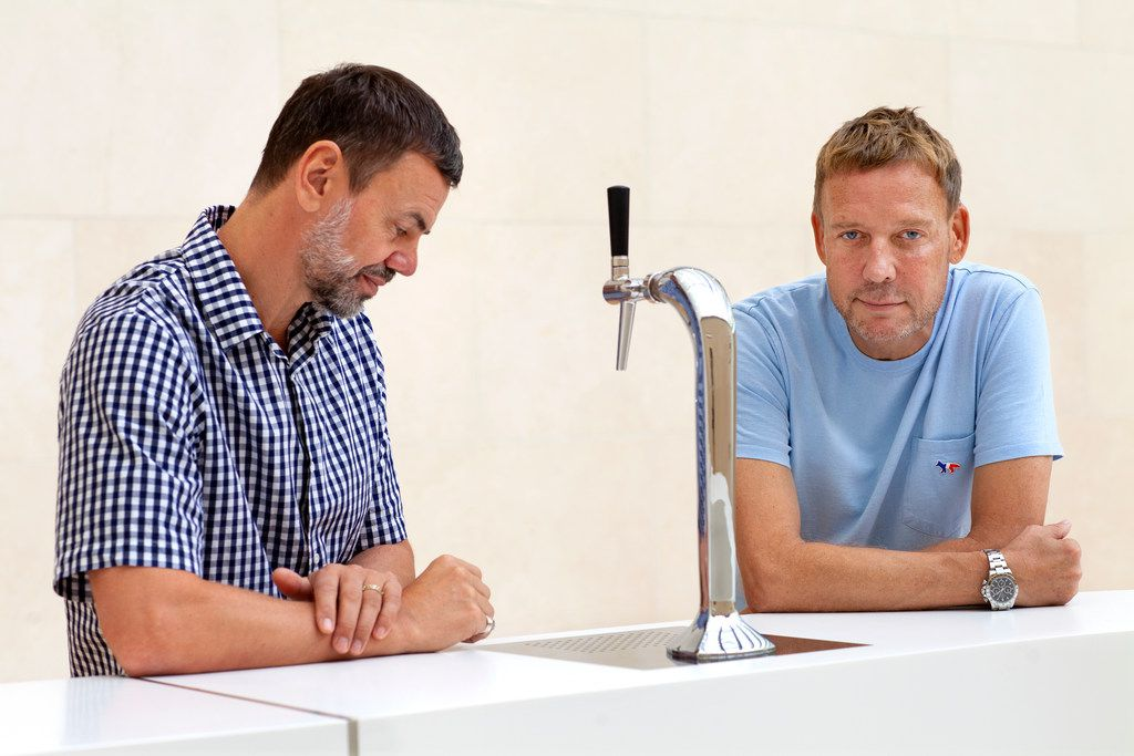 Scandinavian artists Ingar Dragset (left) and Michael Elmgreen work together as Elmgreen & Dragset. They were photographed at their first major museum presentation in the U.S., at the Nasher Sculpture Center, with their work Queer Bar/Powerless Structures, 2018 (detail).