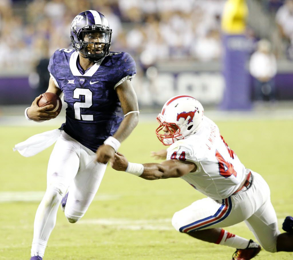TCU Horned Frogs quarterback Trevone Boykin (2) runs past Southern Methodist Mustangs linebacker Jackson Mitchell (44) during the fourth quarter of the TCU and SMU Battle for the Iron Skillet football game at Amon G. Carter Stadium in Fort Worth on Sept. 19, 2015. TCU beat SMU 56-37.