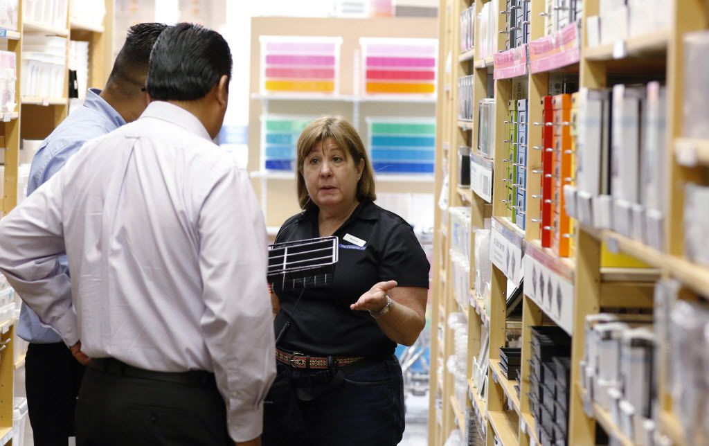 """Marsha Meyers, 66, helps customers at the Container Store in Dallas. """"I like to help people find solutions to problems,"""" she says."""