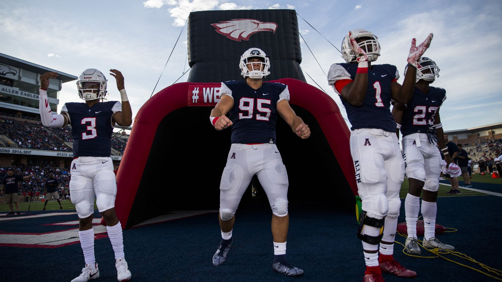 FILE - Allen football players are pictured before a game against Cedar Hill on Friday, Aug. 30, 2019, at Eagle Stadium in Allen.