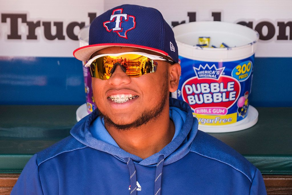 Texas Rangers outfielder Willie Calhoun watches from the dugout before a spring training baseball game against the Cleveland Indians at Globe Life Park on Tuesday, March 26, 2019, in Arlington. (Smiley N. Pool/The Dallas Morning News)