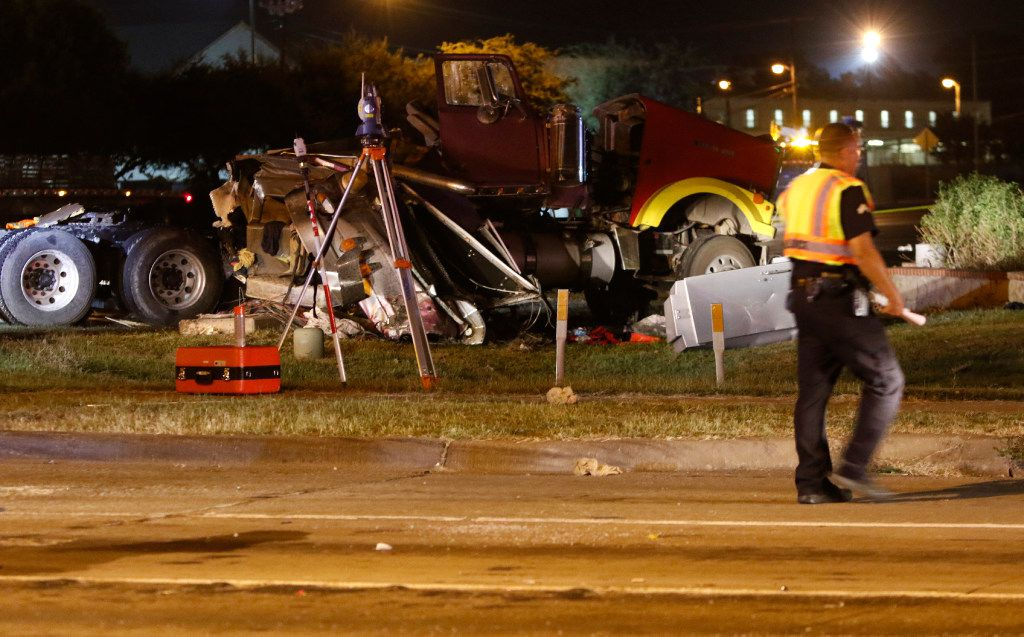 The cab of the truck, where one person was killed Sunday night, September 10, 2017, when a semi-trailer truck collided with a crane from Houston that was hired to remove the Robert E. Lee statue in Oak Lawn.